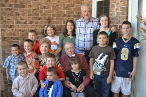 Grandma Carol with Grandpa and some of their great-grandchildren. (My parents are in there as well.)