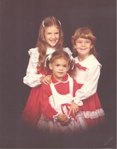Me and my younger sisters in our Christmas finery.